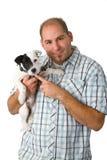他的人小狗年轻人 免版税库存照片