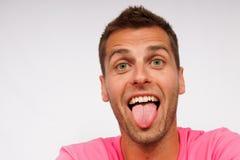 他的人舌头年轻人 免版税库存图片