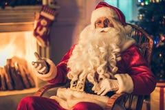 他的住所的圣诞老人 免版税库存图片