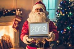 他的住所的圣诞老人 库存照片