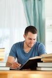 他的复核微笑的学员主题的材料 免版税库存图片