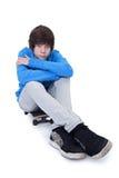 他的滑板少年 免版税库存图片