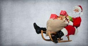 他的爬犁的圣诞老人 免版税库存照片