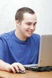他的膝上型计算机学员工作 库存照片