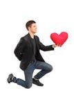他的膝盖供以人员浪漫实践的建议 免版税库存图片