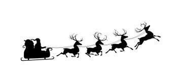 他的驯鹿圣诞老人剪影 免版税库存照片