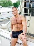 他的水手游艇 库存照片