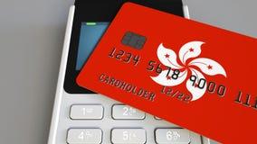 付款或POS终端有以香港为特色的旗子信用卡的 零售商务或银行业务系统概念性3D 免版税库存图片