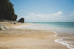 令人惊讶的金黄海滩在巴厘岛 免版税库存照片
