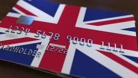 以大英国的旗子为特色的塑料银行卡 全国银行业务相关系统3D翻译 免版税库存照片
