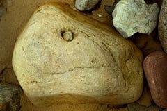 以头的形式石头 免版税库存照片
