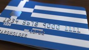以希腊的旗子为特色的塑料银行卡 全国银行业务相关系统3D翻译 免版税库存图片