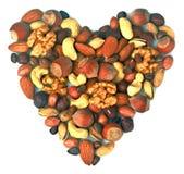 以心脏的形式混合坚果 图库摄影