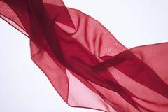 以波浪的形式抽象明亮的五颜六色的织品背景 免版税库存照片