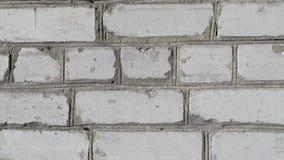 以白色砖的形式,照相机的光滑的运动墙壁的真正的纹理  股票视频
