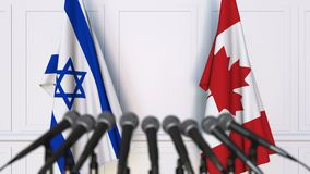 以色列和加拿大的旗子在国际会议或交涉新闻招待会 股票录像