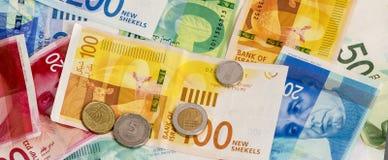 以色列新的锡克尔钞票和硬币背景 概念性ima 免版税图库摄影