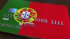 以葡萄牙的旗子为特色的塑料银行卡 全国银行业务相关系统3D翻译 免版税图库摄影