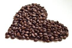 以重点的形式咖啡豆 免版税图库摄影