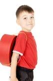 以重点的形式,一个小的儿童立场是与背包 免版税库存图片