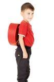 以重点的形式,一个小的儿童立场是与背包 库存照片