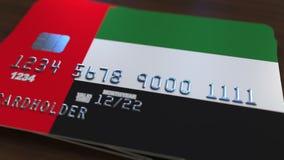 以阿联酋为特色,阿拉伯联合酋长国的旗子的塑料银行卡 全国银行业务相关系统3D翻译 免版税库存照片