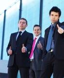 企业人员聪明的三个年轻人 免版税库存图片