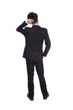 企业人认为的后面姿势 免版税库存图片