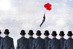 企业变动概念飞行气球 免版税库存照片