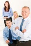 企业同事愉快的经理前辈小组 免版税库存照片