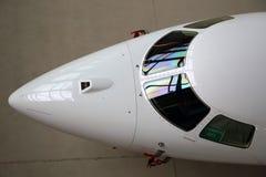 企业喷气机飞机驾驶舱玻璃和鼻子纪念品 免版税库存照片