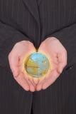 企业地球藏品妇女 免版税库存图片