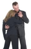 企业夫妇拥抱 免版税图库摄影