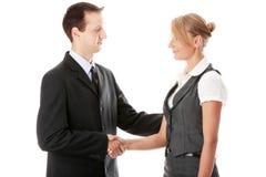 企业夫妇符号交换年轻人 免版税库存照片
