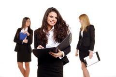 企业女孩性感的三个年轻人 库存照片