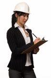 企业安全帽妇女 库存照片