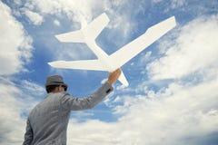 企业家商人送白色飞机入天空 库存图片