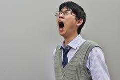 企业家沮丧的男呼喊的年轻人 免版税图库摄影