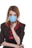 企业屏蔽医疗佩带的妇女 库存图片