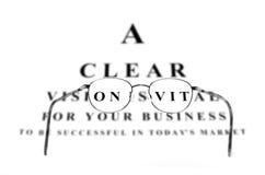 企业成就和玻璃的视力检查表 免版税库存图片