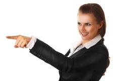 企业手指现代指向的微笑的妇女 免版税图库摄影