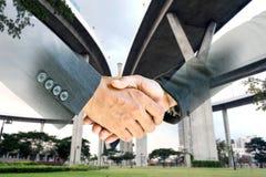 企业握手两次曝光  库存照片