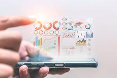 企业数据信息从智能手机提出 免版税库存照片