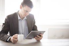企业断裂片剂个人计算机 免版税库存照片