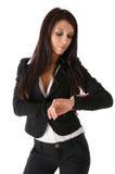 企业时钟注意的妇女 免版税库存图片