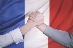 企业有法国旗子的队手 免版税库存图片