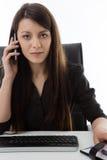 企业服务台她坐的妇女 库存图片