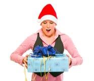 企业查找圣诞老人妇女的礼品帽子 免版税图库摄影
