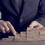 企业概念查出的成功白色 免版税库存照片