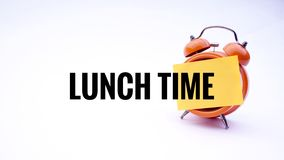 企业概念的概念性图象与词午餐时间的在一个时钟有白色背景 选择聚焦 免版税库存图片